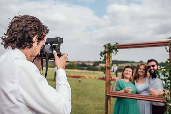 A rustic and bespoke photo booth that uses the natural view