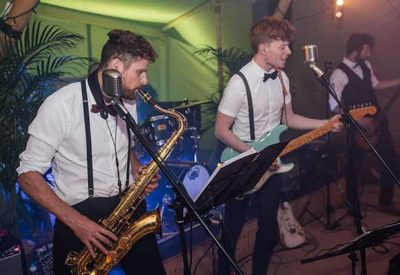 Band in action with saxophone