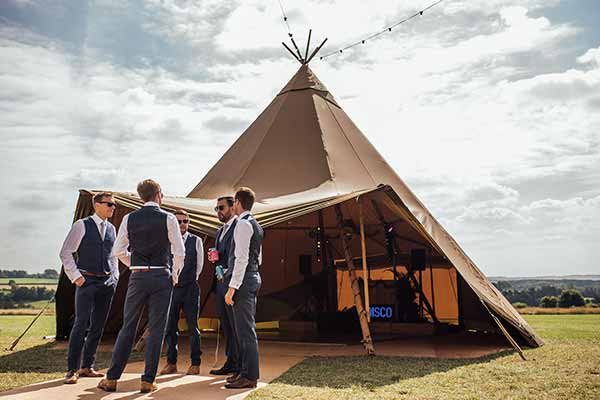 Groomsmen in front of the Disco Tipi