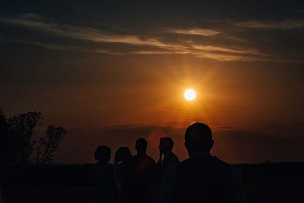 Groomsmen catching some sunset rays