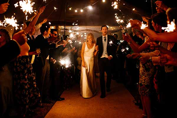 Bride and Groom leaving in an arch of sparklers