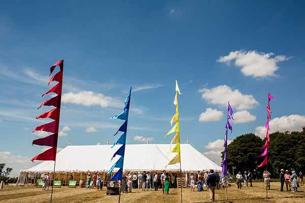 Traditional pole marquee and festival flags