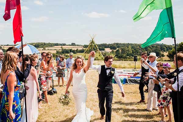 Walking down the aisle with beautiful Cotswold vista