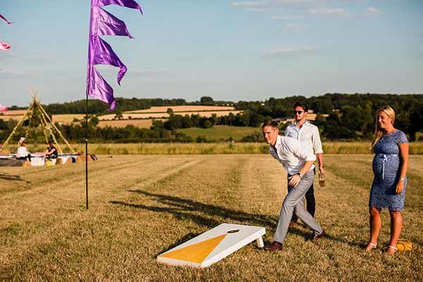 A competitive game of giant cornhole