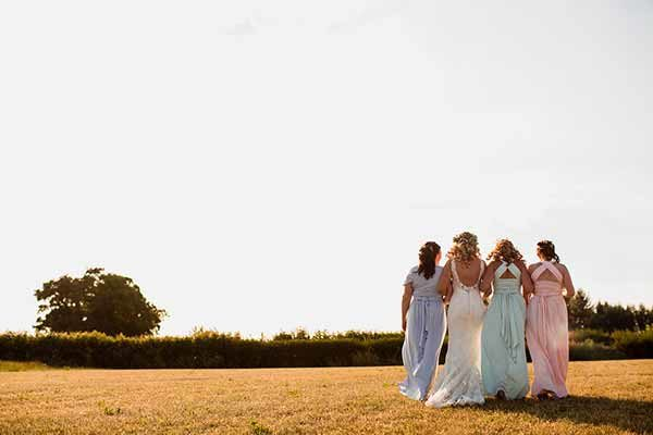 Bridesmaids enjoying a walk in to the sunset