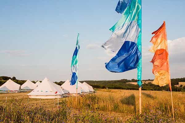 Festival flags mark the entrance to the tipi village