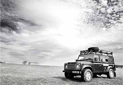 The Wild Oven cooking out of their Land Rover Vehicle